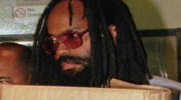 Mumia Gets, and Gives, literary Praise