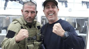 Armed Jerry Seinfeld, who favors gun control at home, poses with Israeli tour guide.