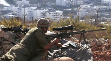 Israeli sniper prepares to implement the piece process.